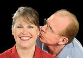 Middle Aged Husband Kisses Wife — Stock Photo