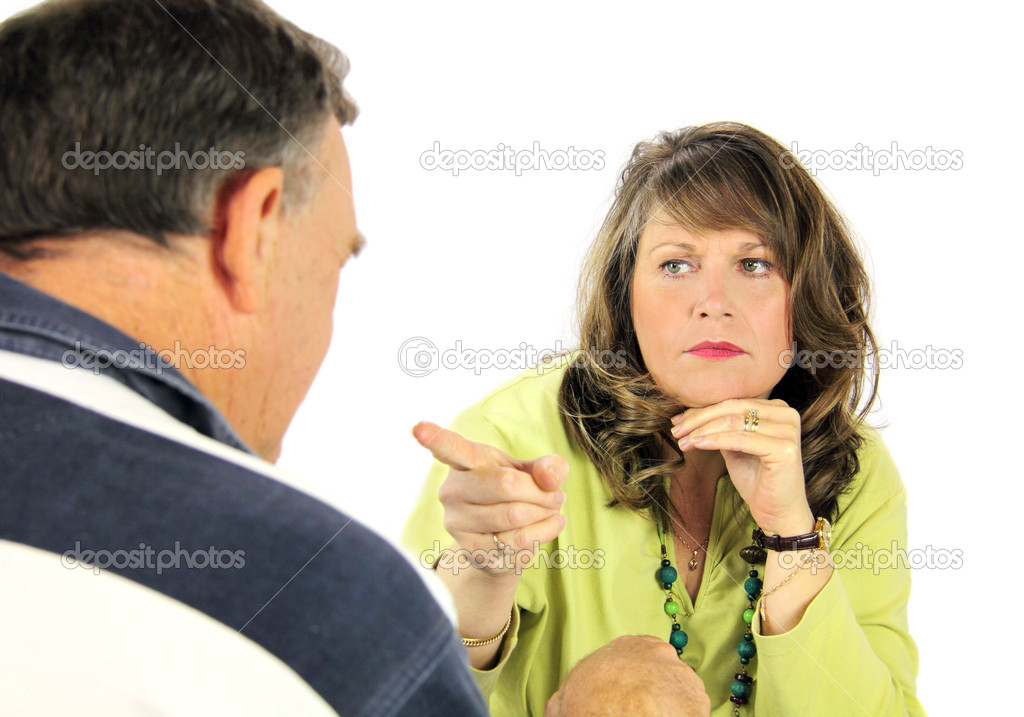 Middle aged arguing couple pointing and accusing each other. — Stock Photo #11666025