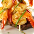 Stock Photo: Shrimps On Steak