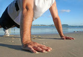 Pushups On The Beach — Stock Photo