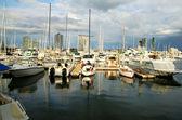 Marina Boats Against Towers — Stock Photo