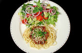 Spaghetti Bolognese And Salad — Stock Photo