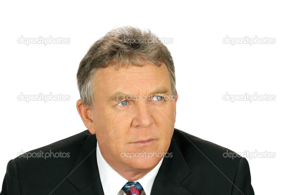 Middle aged distrusting businessman looks camera right with a wary look.  Stock Photo #11776829