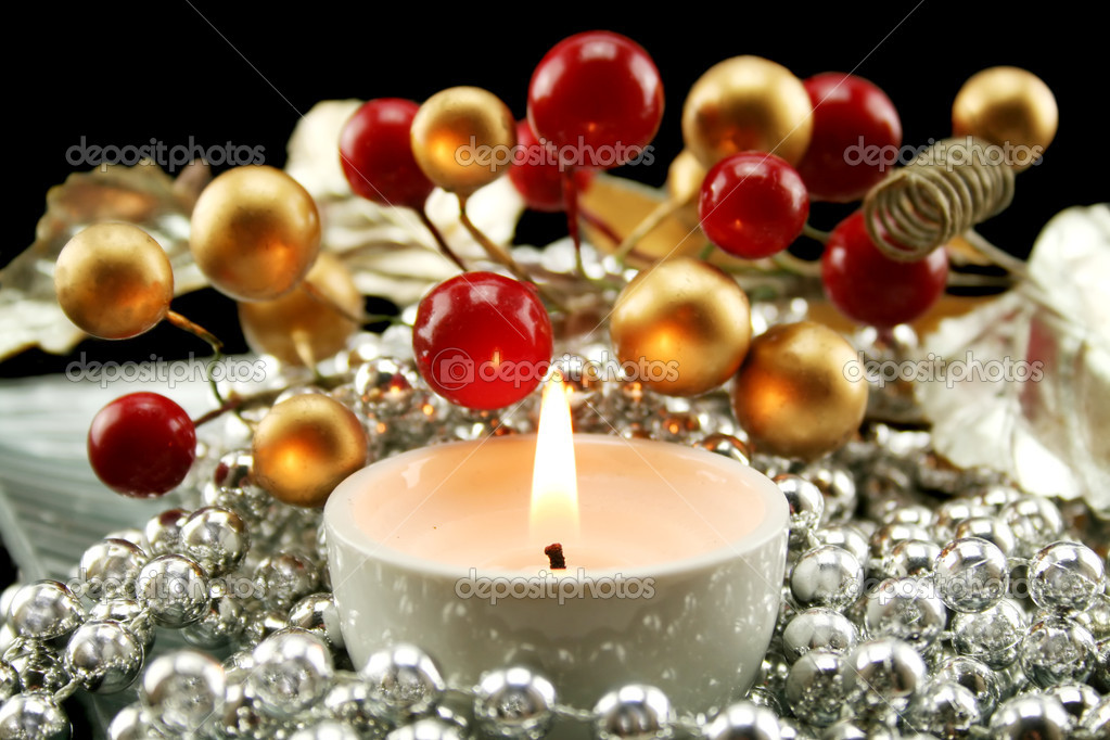 Christmas decoration made from silver necklace with berries and leaves with a candle. — Stock Photo #11778727