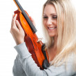 Young smiling woman holding a violin — Stock Photo