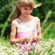 The little girl is standing in the meadow — Stock Photo
