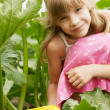 The young girl is in the garden — Stock Photo
