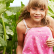 The little girl is in the garden — Stock Photo