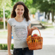 Stock Photo: Young smiling girl staying with basket