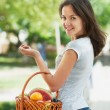 Girl with a basket of fruit and vegetables — Stock Photo