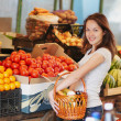 The smiling girl in the market — Stock Photo #12132690