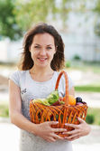 The girl with basket of food — Stock Photo