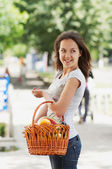 The girl with the basket — Stock Photo
