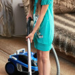 The girl is vacuuming — Stock Photo #12392385