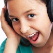 The girl is listening to music — Stock Photo #12392387