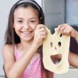 Stock Photo: Girl is showing her mask