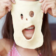 The girl is showing her mask — Stock Photo #12392395