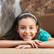 The girl is lying the carpet — Stock Photo