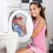 Stock Photo: The young girl is washing clothes