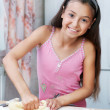 The girl is kneading the dough — Stock Photo