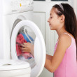 Stock Photo: The girl is washing clothes