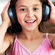 The girl is listening to music — Stock Photo