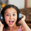 Stock Photo: The girl is listening to music