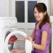 The nice girl is washing clothes — Stock Photo