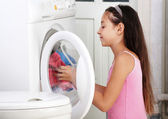The girl is washing clothes — Stock Photo