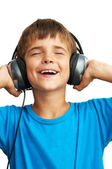 The boy is holding the headphones — Stock Photo