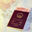 Chinese passport yuan on the world map — Stock Photo