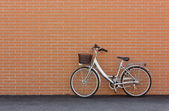 Bicycle against a Brick Wall — Stock Photo