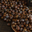 Hazelnuts in Motion Tumbling into Wooden Box — Stock Photo #11945416