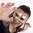Young attractive masked woman — Stok fotoğraf