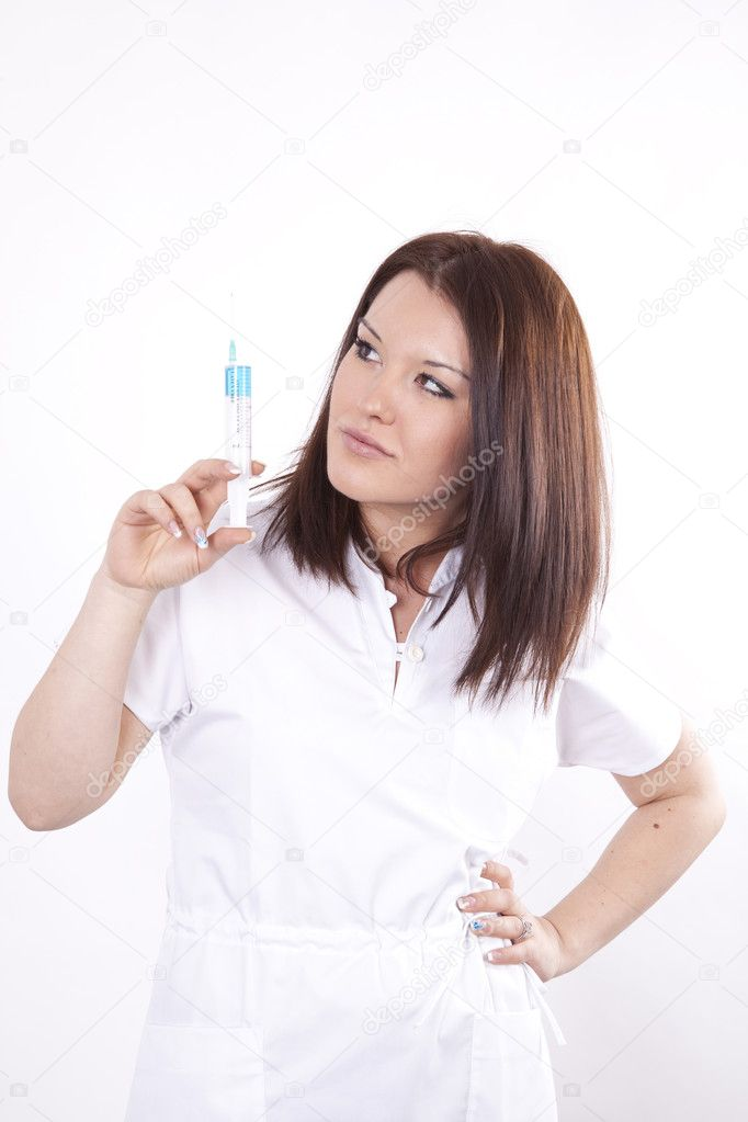 Young attractive female doctor pointing syringe up. — Stock Photo #11509740