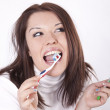 Young beautiful woman cleaning her teeth — Stock Photo #11510337