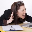 Young beautiful woman yelling at her laptop — Stock Photo