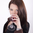 Young beautiful woman drinking glass of red wine — Stock Photo #11516888