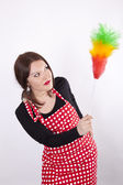 Young beautiful housewife dusting — Stock Photo