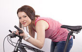Young beautiful woman holding bicycle — Stock Photo