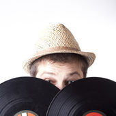 Young man holding two vinyl LP-s — Stock Photo