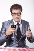 Young man with a glass of wine — Stock Photo