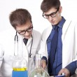Two young male laboratory technicians — Stock Photo #11640238