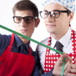Two men with measuring tape — Stock Photo