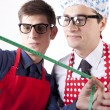 Two men with measuring tape — Stock Photo #11640503