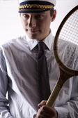 Young man holding a racket — Stock Photo