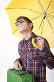 Young man with yellow umbrella — Stock Photo