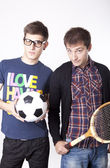 Two man holding ball and racket — Stok fotoğraf