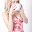 Young attractive woman drinking coffee — Stock Photo #11677496