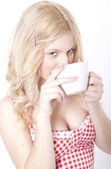 Young attractive woman drinking coffee — Stock Photo